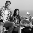 Biker man and girl — Stockfoto