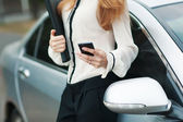 Young beautiful woman writes an SMS — Stock Photo