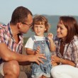 Happy family having fun outdoors and smiling — Stockfoto #31733313