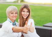 Adult mother and daughter showing OK — Stock Photo