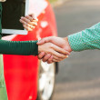 Business handshake to close the deal after buying a car — Stock Photo #32397617