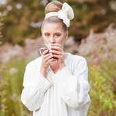 Girl with tea. — Stock Photo