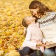Mother and daughter in the autumn park — Stock Photo #33092643