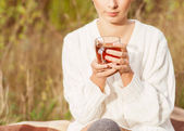 Pretty young girl drinks tea in retro clothes, — Stock Photo