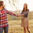 Young happy attractive couple walking together, outdoors — Stock Photo