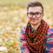 Guy laughing in the autumn park. hipster Style — Stock Photo