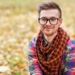 Guy laughing in the autumn park. hipster Style — Stock Photo #33644243