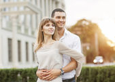 Young couple in love outdoor. She pressed against him, he is a g — Stock Photo