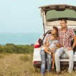 Family in the mountains by car — Stock Photo