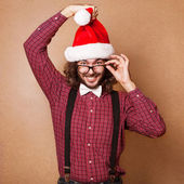 Photo of Santa Claus looking at camera. Hipster style. — Photo