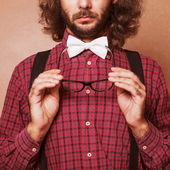 Hipster guy 's clothes in a cage , suspenders and white butterfl — Stock Photo
