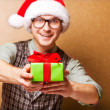 Bright picture of handsome man holding gift boxes — Стоковая фотография