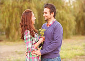 Young couple in love walking in the autumn park near the river. — Stock Photo