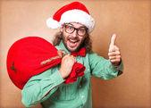 Santa Claus with a bag of gifts looking at camera — Stock Photo