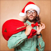 Santa Claus with a bag of gifts — Stock Photo