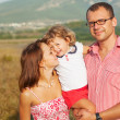 Stockfoto: Happy mother, father and daughter