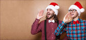 Two guys in hipster clothes of Santa Claus in a Christmas shout — Stock Photo