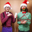 Two guys to play with Christmas garland — Foto de Stock