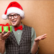 Bright picture of handsome man in christmas hat. — Stock Photo