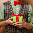 Guy holding a gift — Stock Photo