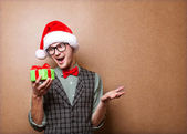 Guy holding a gift and emotionally happy Christmas — Stock fotografie