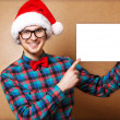 Hipster Santa Claus pointing in white blank sign with smile — Stock Photo