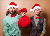 Two emotional Santa Claus dressed in clothes hipster — Stock Photo