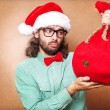 Christmas Santa hat isolated man portrait hold christmas gift — Stock Photo