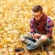 Young hipster relaxed man reading book in nature — Stock Photo