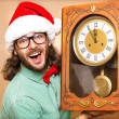 Photo of stunned Santa holding clock showing five minutes to mid — Stock Photo #36683703