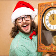 Photo of stunned Santa holding clock — Stock Photo