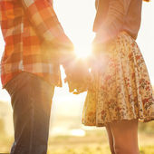 Young couple in love walking in the autumn park — Stock Photo