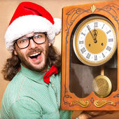 Photo of stunned Santa holding clock showing five minutes to mid — Stock Photo
