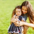 Mother and daughter in the park happy — Stock Photo
