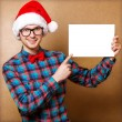 Hipster Santa Claus pointing in white blank sign with smile, iso — Stock Photo #37019493