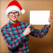 Hipster Santa Claus pointing in white blank sign with smile, iso — Stock Photo