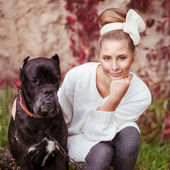 Portrait of a young girl hugging a big dog Cane Corso — Stock Photo