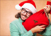Hipster Santa Claus with the bag of the presents — Stock Photo
