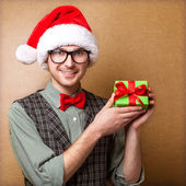Guy holding a gift and emotionally happy Christmas — Стоковое фото