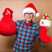 Guy holding a gift and emotionally happy Christmas — ストック写真