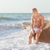 Vibrant fashion portrait of a sexy muscular fit man — Stock Photo
