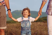 Happy mother and father with daugther — Stock Photo