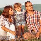 Happy family having fun outdoors and smiling — Stock Photo