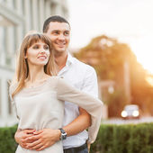 Young couple in love outdoor. She pressed against him — Stock Photo