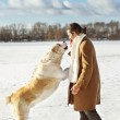 Man and central Asian shepherd playing with his dog outdoors — Stock Photo #37729297