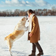 Man and central Asian shepherd playing with his dog outdoors — Stock Photo