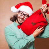 Guy holding a gift and emotionally happy Christmas — 图库照片