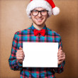 Santa Claus pointing in white blank sign with smile — Stock Photo