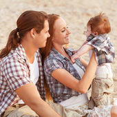Happy mother, father and son in sunset — Foto Stock