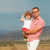 Father and daughter walking on the mountains — Stock Photo